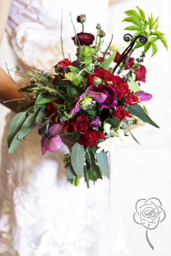 Boho style bouquet  with red roses, ranunculus, hellebore, orchids, mushrooms, lotus