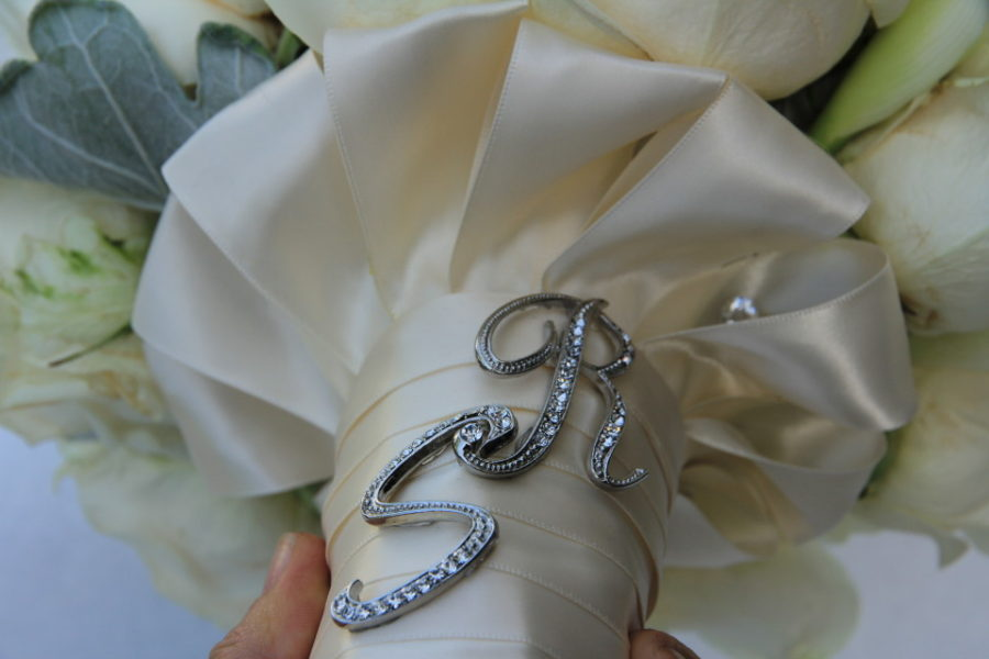 Bridal bouquet wrap with initials of a couple