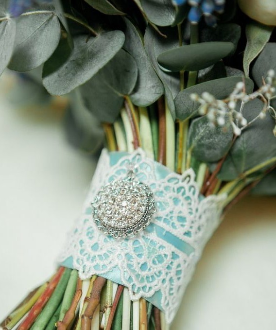 Wedding bouquet wrapping  with  a lace and a brooch